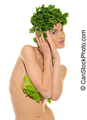 sexy woman with clothes made ??of vegetables