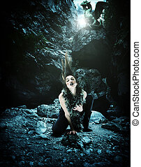 Woman with dragon in a cave