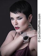 Sexy woman with elegant silver jewelry