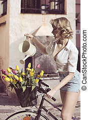 sexy woman with floral bicycle