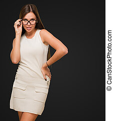 Sexy woman with glasses posing