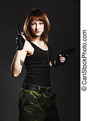 Sexy woman with Gun on dark