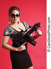 Sexy woman with gun