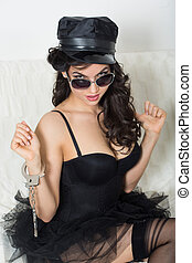 sexy woman with handcuffs in fashion glasses. role-playing...