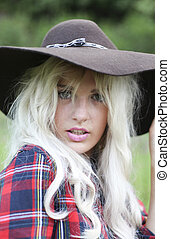 Sexy woman with long blonde hair wearing a hat