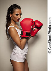 Sexy woman with red boxing gloves