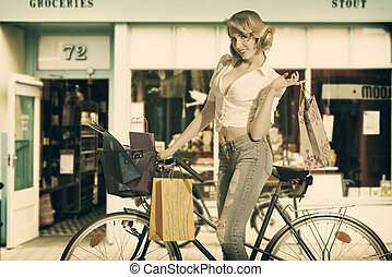 sexy woman with shopping bags in vintage color