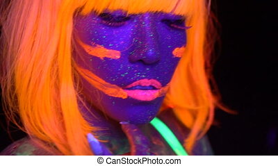 Sexy woman with UV fluorescent face and body makeup -...