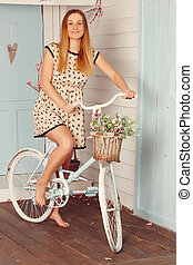Sexy woman with vintage bike