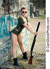 Sexy woman with weapon - Sexy military woman model with...
