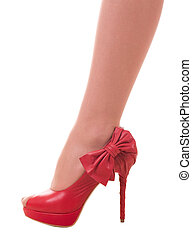 Sexy womanish leg in red shoe