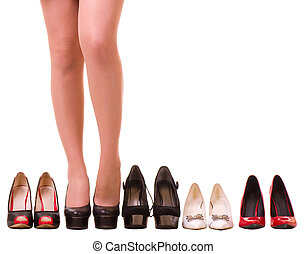 Sexy woman's legs with fashion shoes isolated on white...