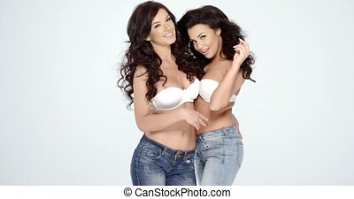 Sexy Women Wearing White Bras and Jeans
