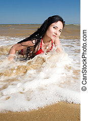 Sexy young adult woman at the sea