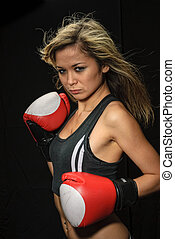 Sexy young blond woman with red boxing gloves