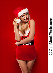 Sexy young blonde in a Santa Claus outfit