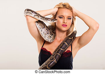 blonde woman posing with python