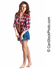 Sexy young caucasian brunette woman wearing red plaid shirt, isolated on white
