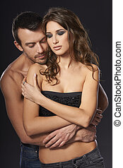 Sexy young couple embracing - A sexy young topless couple...