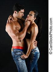 Sexy young couple with blue jeans standing together - Sexy...
