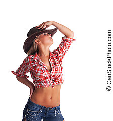 sexy young cowgirl take hand on hat isolated - pretty young...