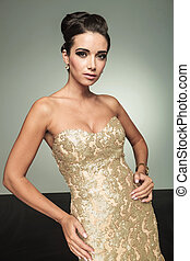sexy young elegant woman posing in studio