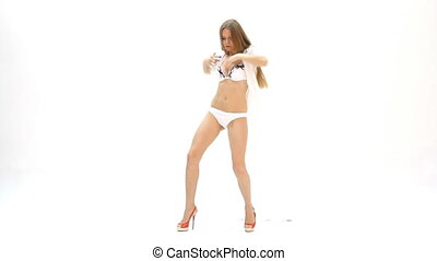 sexy young girl dancing against white background