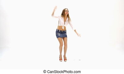 sexy young girl dancing against whi