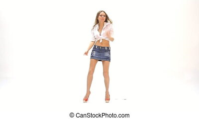 young girl dancing against white background