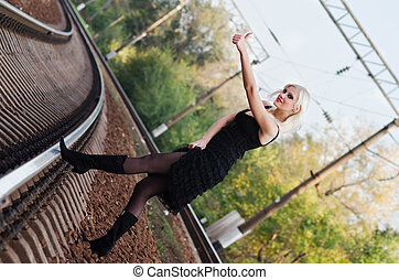 Sexy young girl is hitchhiking on a railroad - Sexy young ...