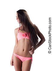 Sexy young girl posing in fashionable pink bikini