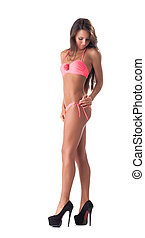 Sexy young girl posing in trendy pink bikini