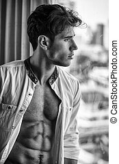 Sexy young man with shirt open on muscular chest - Sexy ...