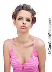 Sexy young model with hair curlers