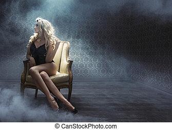 Sexy young woman among white smoke