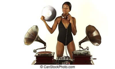 sexy young woman djs using two retro antique gramophones. ...