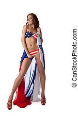 Sexy young woman in bikini with fabric