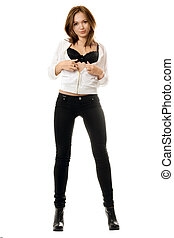 Sexy young woman in black tight jeans