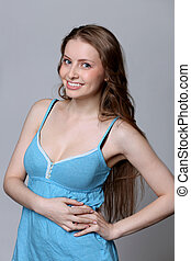Sexy young woman in blue dress