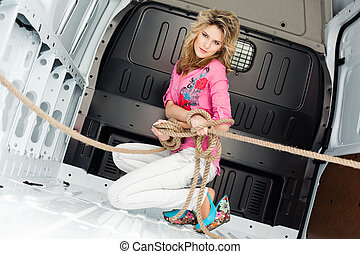 Sexy young woman in cargo van insid