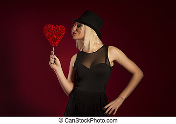sexy young woman in fashionable dress with heart