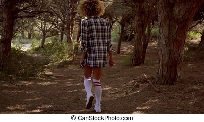Sexy young woman in knee-highs walking - Sexy young woman in...
