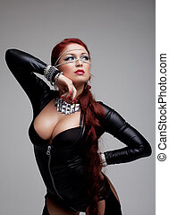 Sexy young woman in latex costume with huge breast