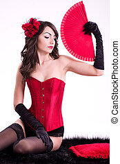 Sexy young woman in red corset