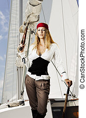 Sexy young woman pirat on the schooner holding a flintlock...