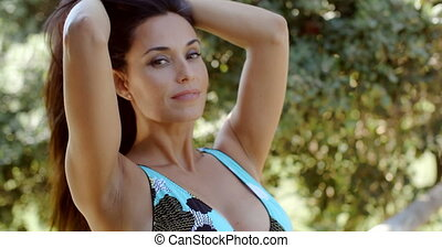 Sexy Young Woman Posing at the Beach Garden
