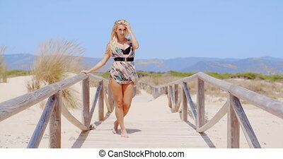 Sexy Young Woman Posing at the Beach Pathway