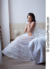 Sexy young woman posing in wedding underskirt
