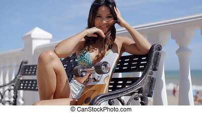 Sexy young woman relaxing on a bench at the sea - Sexy young...