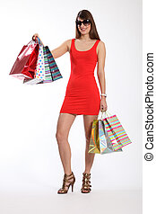 Sexy young woman shopping in short red dress